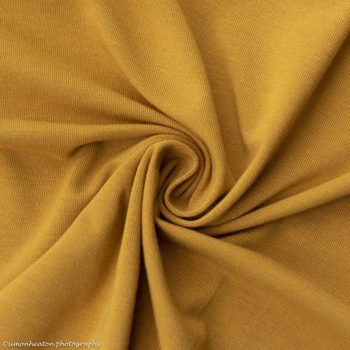 bamboo jersey fabric with organic cotton in ochre harvest gold
