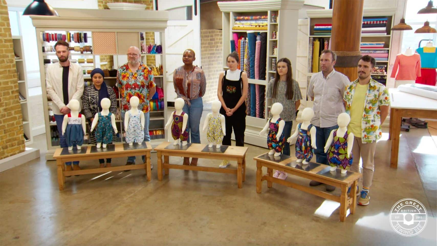 The contestants with their finished romper suits